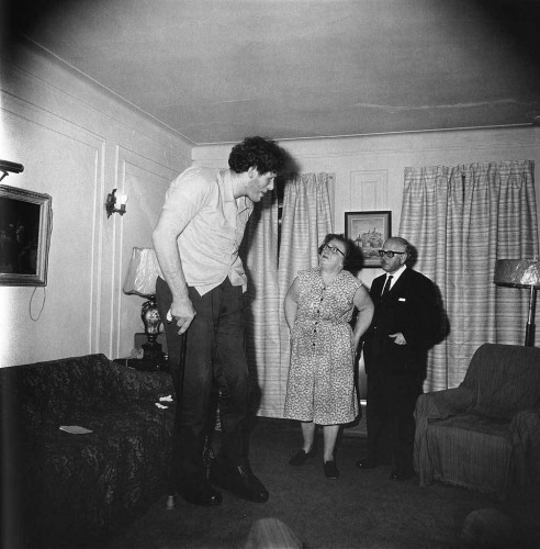 A Jewish giant at home with his parents in the Bronx, N.Y.C. 1970